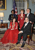 The 2003 Kennedy Center Honors recipients pose for a group photo after a dinner at the United States State State Department hosted by United States Secretary of State Colin Powell in Washington, DC on December 6, 2003.  Honorees, clockwise from foreground left are singer Loretta Lynn, singer James Brown, comedian Carol Burnett, director Mike Nichols, and violinist Itzhak Perlman...Credit: Robert Trippett - Pool via CNP