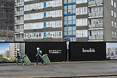 Block due for demolition and builders, West Hendon estate Barratt redevelopment London