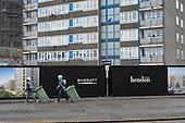 Block due for demolition and builders, West Hendon estate Barratt redevelopment London
