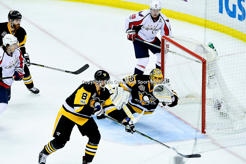 May 1, 2017: Pittsburgh Penguins goalie Marc-Andre Fleury (29) makes a glove save during game 3 of the second round of the National Hockey League Eastern Conference Stanley Cup Playoffs between the Washington Capitals and the Pittsburgh Penguins, held at PPG Paints Arena, in Pittsburgh, PA. Eric Canha/CSM