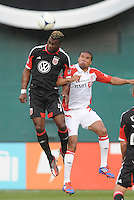 D.C. United defender Brandon McDonald (4) heads the ball against Toronto FC forward Ryan Johnson (9) D.C. United defeated Toronto FC 3-1 at RFK Stadium, Saturday May 19, 2012.