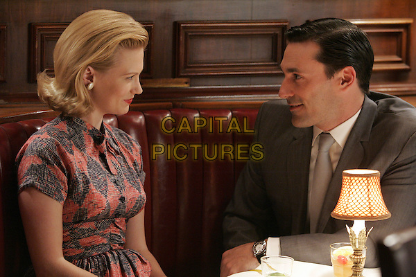 JANUARY JONES &amp; JON HAMM<br /> in Mad Men (Season 1)<br /> *Filmstill - Editorial Use Only*<br /> CAP/FB<br /> Image supplied by Capital Pictures