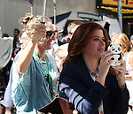 Debra Messing photographing 'Naked Cowboy'  filming a scene from the NBC TV Show 'Smash' in Times Square, New York City on September 12, 2012
