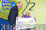 Patsy Griffin, Spa Road  celebrate her win in the radio Kerry Rehab Bingo  Jackpot when breakfast show's  Brian Percell  presented her with a cheque for €10,000 at  the Studio on Wednesday.