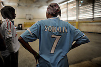 Suweys´ team trains behind bullet-ridden walls, in the ruins of the failed city of Mogadishu - protected by heavily armed gun-men. The women live in constant fear of the islamist killer commandos. Stop playing basketball? Never, they say..Women´s basketball in the world´s most dangerous capital...Death or Play. Women´s Basketball in Mogadishu.Women's basketball? In Europa and the U.S., we take it for granted. But consider this: In Mogadishu, war-torn capital of Somalia, young women risk their lives every time they show up to play..Suweys, the captain of the Somali women´s basketball team, and her friends play the sport of the deadly enemy, called America. This is why they are on the hit list of the killer commandos of Al Shabaab, a militant islamist group, that has recently formed an alliance with the terrorist group Al Qaeda and control large swathes of Somalia...Al Shabaab, who sets bombs under market stands, blows up cinemas, and stones women, has declared the female basketball players ?un-islamic?. One of the proposed punishments is to saw off their right hands and left feet. Or simply: shoot them....