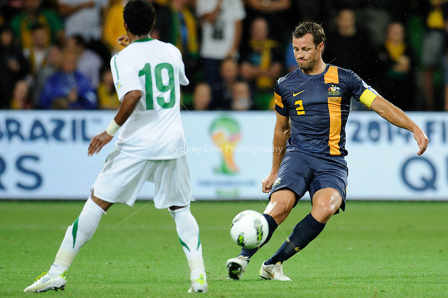 The Australian team captain Lucas NEILL (2) kicks the ball during the FIFA 2014 World Cup Group D Asian Qualifier match between Australia and Saudi Arabia at AAMI Park in Melbourne, Australia...This image is not for sale on this web site. Please contact Southcreek Global Media for licensing:.Toll Free: 1.800.934.5030.Canada: 701 Rossland Rd. East, Suite 315, Whitby, Ontario, Canada, L1N 9K3.USA: 10792 Baron Dr, Parma OH, USA 44130.Web: http://southcreekglobal.net/ and http://southcreekglobal.com/