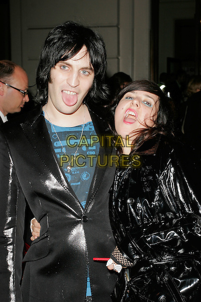 NOEL FIELDING & DEE PLUME.Leaving the GQ Men of the Year Awards at the Royal Opera House, Covent Garden, London, England..September 2nd 2008.departures half length couple black shiny mac jacket mouth open tongue funny face.CAP/AH.©Adam Houghton/Capital Pictures.