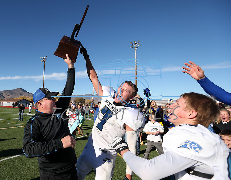 Pahranagat Valley Head Coach Ken Higbee and Shawn Wadsworth celebrate after defeating Whittell 54-28 in the NIAA DIV championship game at Dayton High School in Dayton, Nev., on Saturday, Nov. 21, 2015. (Cathleen Allison/Las Vegas Review Journal)