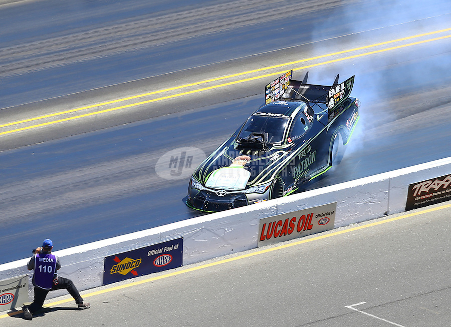 Jul 31, 2016; Sonoma, CA, USA; NHRA funny car driver Alexis DeJoria loses control and hits the wall alongside photographer Jeff Burghardt during the Sonoma Nationals at Sonoma Raceway. DeJoria was uninjured in the crash. Mandatory Credit: Mark J. Rebilas-USA TODAY Sports