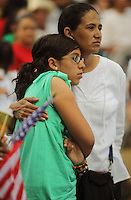 Phoenix, Arizona, USA-- Protestors comfort eachother while attending a protest against Arizona's new immigration law during a May 1, 2010, protest outside the Arizona State Capitol.  (Pat Shannahan/ The Arizona Republic)