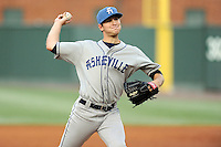 Starting pitcher Konner Wade (11) of the Asheville Tourists delivers a pitch in a game against the Greenville Drive on Monday, April 21, 2014, at Fluor Field at the West End in Greenville, South Carolina. Greenville won, 8-3. (Tom Priddy/Four Seam Images)