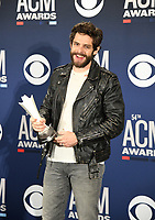 LAS VEGAS, NEVADA - APRIL 07: Male Artist of the Year award winner Thomas Rhett poses in the press room during the 54th Academy Of Country Music Awards at MGM Grand Hotel &amp; Casino on April 07, 2019 in Las Vegas, Nevada. <br /> CAP/MPIIS<br /> &copy;MPIIS/Capital Pictures