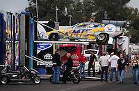 Jan 23, 2009; Chandler, AZ, USA; The car of NHRA funny car driver Jack Beckman is unloaded from the hauler during testing at the National Time Trials at Firebird International Raceway. Mandatory Credit: Mark J. Rebilas-