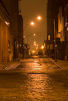 THIS IMAGE IS AVAILABLE EXCLUSIVELY FROM GETTY IMAGES.....PLEASE SEARCH FOR IMAGE # 77184626 ON WWW.GETTYIMAGES.COM.....Mysterious Urban Street Scene Illuminated at Night in the DUMBO neighborhood of Brooklyn, New York.
