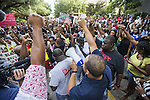 BATON ROUGE, LA - JULY 09: Protesters start the march from Baton Rouge City Hall to the Louisiana Capitol with a prayer in protest of the shooting of Alton Sterling on July 9, 2016 in Baton Rouge, Louisiana. Alton Sterling was shot by a police officer in front of the Triple S Food Mart in Baton Rouge on July 5th, leading the Department of Justice to open a civil rights investigation. (Photo by Mark Wallheiser/Getty Images)