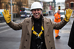 © Joel Goodman - 07973 332324 .  12/01/2015 . Salford , UK . BEZ ( Mark Berry ) (wearing a safety harness ) launches his parliamentary campaign for the constituency of Salford and Eccles at a poster site on Chapel Street , Salford . Bez , the freaky dancer from Madchester band The Happy Mondays , is standing for The Reality Party . Seat incumbent , Labour's Hazel Blears , is standing down at the 2015 election . Photo credit : Joel Goodman
