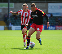 Lincoln City's Harry Anderson vies for possession with Swindon Town's Matthew Taylor<br /> <br /> Photographer Andrew Vaughan/CameraSport<br /> <br /> The EFL Sky Bet League Two - Lincoln City v Swindon Town - Saturday August 11th 2018 - Sincil Bank - Lincoln<br /> <br /> World Copyright &copy; 2018 CameraSport. All rights reserved. 43 Linden Ave. Countesthorpe. Leicester. England. LE8 5PG - Tel: +44 (0) 116 277 4147 - admin@camerasport.com - www.camerasport.com
