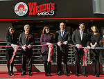 December 27, 2011, Tokyo, Japan - U.S. Ambassador to Japan and Mrs. John Roos, center, take part in a ribbon-cutting ceremony to re-launch a Wendy's fast-food restaurant in Tokyo on Tuesday, December 27, 2011. In December 2009, Wendys did not renew its franchise agreement with its former franchisee for Japan, resulting in the closure of 71 restaurants. Wendys and Higa Industries, a successful food importer and distributor based in Tokyo, signed a joint venture agreement to develop and operate Wendys restaurants in Japan. Wendys Japan plans to open 100 stores in the next five years. (Photo by Natsuki Sakai/AFLO) [3615] -mis-