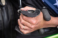 Morehead City, NC -- Paul Kelly has limited use of his fingers, so custom handles that grip his wrists allow him to push and pull with his wrists.  Quadriplegic hand cyclist Paul Kelly, 62, trains for the Boston Marathon Tuesday, March 27, 2018. (Justin Cook for The Wall Street Journal)<br /> <br /> SUMMARY:<br /> <br /> Paul Kelly, hand cyclist, Beaufort, NC Training for the Boston Marathon so we would want to shoot in March to run the week before the marathon or marathon Monday, Apriln16. Life as a quadriplegic doesn&rsquo;t keep 62-year-old Paul Kelly on the sidelines. After breaking his neck in a swimming accident in 1978, Kelly was determined to find fitness activities to maintain an active lifestyle. He discovered handcycles while watching his niece compete in the 2006 Marine Corps Marathon and was inspired to start his own marathon career to stay fit. Paul has competed in over 100 half and full marathons. On April 16, he will celebrate his 40th year of living as a quadriplegic by taking on one of the most coveted races for a marathoner -- the Boston Marathon. Kelly is among the 60 handcyclists competing in the 2018 Boston Marathon with a qualifying time of 1:26:37. Most of Paul&rsquo;s distance training takes place at Bogue Banks, which includes Atlantic Beach, Salter Path, and Emerald Isle, N.C. It&rsquo;s Nicholas Sparks worthy scenery with its marshes, waterways, inlets and small islands. Paul is particularly fond of the approach from Atlantic Beach to Bogue Banks -- it&rsquo;s via the high-rise bridge. In cold weather, Paul has to be mindful of the environment and dress in a manner that insulates his legs while also allowing his upper body to ventilate. Paul chooses to train at times of day when the temperatures are more reasonable. He uses hand warmers in his gloves, on the inside the grips on his handcycle and in the legs of his trousers.