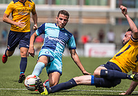 Nick Freeman of Wycombe Wanderers goes in for a challenge with Slough Town captain Alan Inns who suffers a nasty injury during the pre season friendly match between Slough Town and Wycombe Wanderers at Arbour Park Stadium, Slough, England on 8 July 2017. Photo by Andy Rowland.