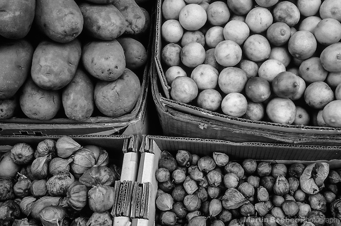 Potatoes, limes, and tomatillos in market, Tijuana, Mexico