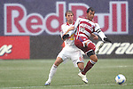 15 April 2007: Dallas's Carlos Ruiz (20) tries to control the ball in front of New York's Jeff Parke (60). The New York Red Bulls defeated FC Dallas 3-0 at Giants Stadium in East Rutherford, New Jersey in an MLS Regular Season game.