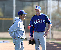 Mike Maddux (pitching coach, Tanner Scheppers (R). Texas Rangers spring training workouts at the Rangers complex, Surprise, AZ - 02/23/2010.Photo by:  Bill Mitchell/Four Seam Images.