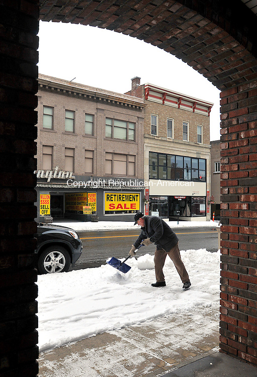 TORRINGTON,  CT, 17 JANUARY  2012-011712JS01-Aldo Canino of Torrington, a maintenance worker for the owers of the Yankee Peddler Inn in Torrington for nine years, clears slow in front of the buildings on Main Street in Torrington on Tuesday. .Jim Shannon Republican-American