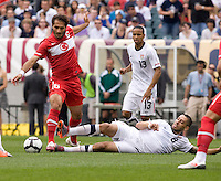 Clint Dempsey (8) of the USMNT tackles the ball away from Hamit Altintop (6) at Lincoln Financial Field in Philadelphia, PA.  The USMNT defeated Turkey, 2-1.