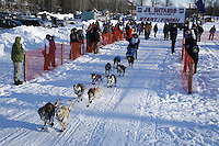 Saturday, February 24th, Knik, Alaska.  Jr. Iditarod musher Chrystiene Lee Salesky leaves start line on Knik Lake