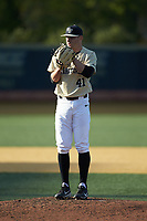 Wake Forest Demon Deacons relief pitcher Jared Shuster (41) looks to his catcher for the sign against the Liberty Flames at David F. Couch Ballpark on April 25, 2018 in  Winston-Salem, North Carolina.  The Demon Deacons defeated the Flames 8-7.  (Brian Westerholt/Four Seam Images)