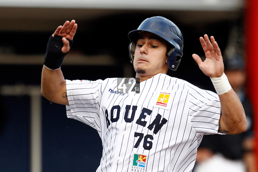 15 July 2011: Maxime Lefevre of the Rouen Huskies slides into home plate during the 2011 Challenge de France match won 6-5 by the Rouen Huskies over the Senart Templiers at Stade Pierre Rolland, in Rouen, France.