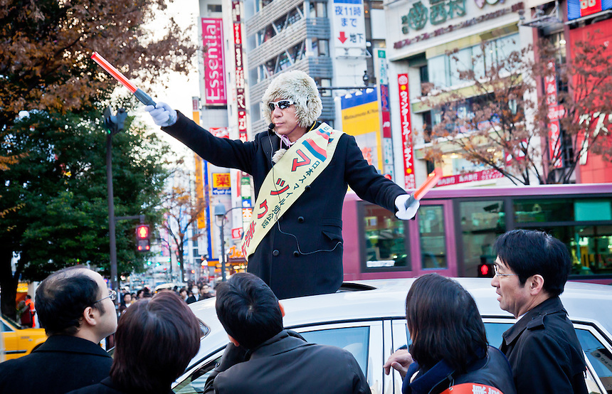 Japan Smile party candidate Maku Akasaka arrives in Shibuya sticking out of the roof of a white Rolls Royce during campaigning.