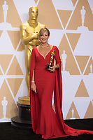 Allison Janney poses backstage with the Oscar&reg; for performance by an actress in a supporting role for work on &ldquo;I, Tonya&rdquo; during the live ABC Telecast of The 90th Oscars&reg; at the Dolby&reg; Theatre in Hollywood, CA on Sunday, March 4, 2018.<br /> *Editorial Use Only*<br /> CAP/PLF/AMPAS<br /> Supplied by Capital Pictures