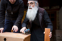 Mount Athos - The Holy Mountain.<br /> A monk teaches a new arrival about carpentry. <br /> Photographer: Rick Findler