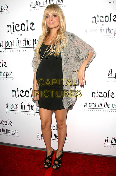 """NICOLE RICHIE .at the launch of """"Nicole for A Pea in the Pod"""" maternity clothing line, Beverly Hills, California, USA, August 6th 2009.                                                                   .full length black mini dress cut out shoes sandals heels peep toe gladiator floral print grey gray kimono style  cardigan pregnant gold necklace hand arm .CAP/DVS.©Debbie VanStory/RockinExposures/Capital Pictures"""