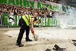 Stockholm 2015-08-24 Fotboll Allsvenskan Djurg&aring;rdens IF - Hammarby IF :  <br /> Personal plockar upp en utbrunnen bengal nedanf&ouml;r Hammarbys supportrar under matchen mellan Djurg&aring;rdens IF och Hammarby IF <br /> (Foto: Kenta J&ouml;nsson) Nyckelord:  Fotboll Allsvenskan Djurg&aring;rden DIF Tele2 Arena Hammarby HIF Bajen supporter fans publik supporters bengal bengaler