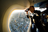 USA, California, San Francisco, man looking out the window of the Airship Ventures Zeppelin, South San Francisco