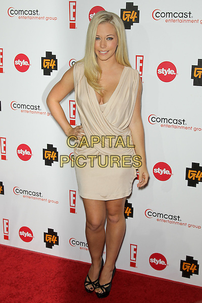 KENDRA WILKINSON.arrives to the Comcast Entertainment Group TCA Cocktail Party, featuring talent from E!, Style Network and G4, at the Beverly Hilton Hotel. Beverly Hills, CA, USA. August 6th, 2010. .full length dress hand on hip beige smiling cleavage cream draped ruched black platform sandals .CAP/CEL.©CelPh/Capital Pictures.