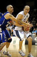 Saints guard Lindsay Tait marks Phill Jones. NBL - Wellington Saints v Nelson Giants at TSB Bank Arena, Wellington, New Zealand on Thursday, 19 May 2011. Photo: Dave Lintott / lintottphoto.co.nz