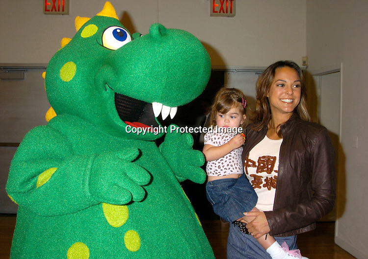 """Dragon, Eva La Rue and daughter Kaya Callahan ..at the 3rd Annual """"Children's Day Artrageous"""" on April 25, 2004 benefitting Edwin Gould Services for Children and ..Families at The Metropolitan Pavilion in New York City...Photo by Robin Platzer, Twin Images"""