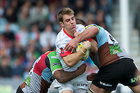 Chris Wyles of Saracens is tackled by Jordan Turner-Hall (left) and Ollie Kohn of Harlequins during the Aviva Premiership match between Harlequins and Saracens at the Twickenham Stoop on Sunday 30th September 2012 (Photo by Rob Munro)