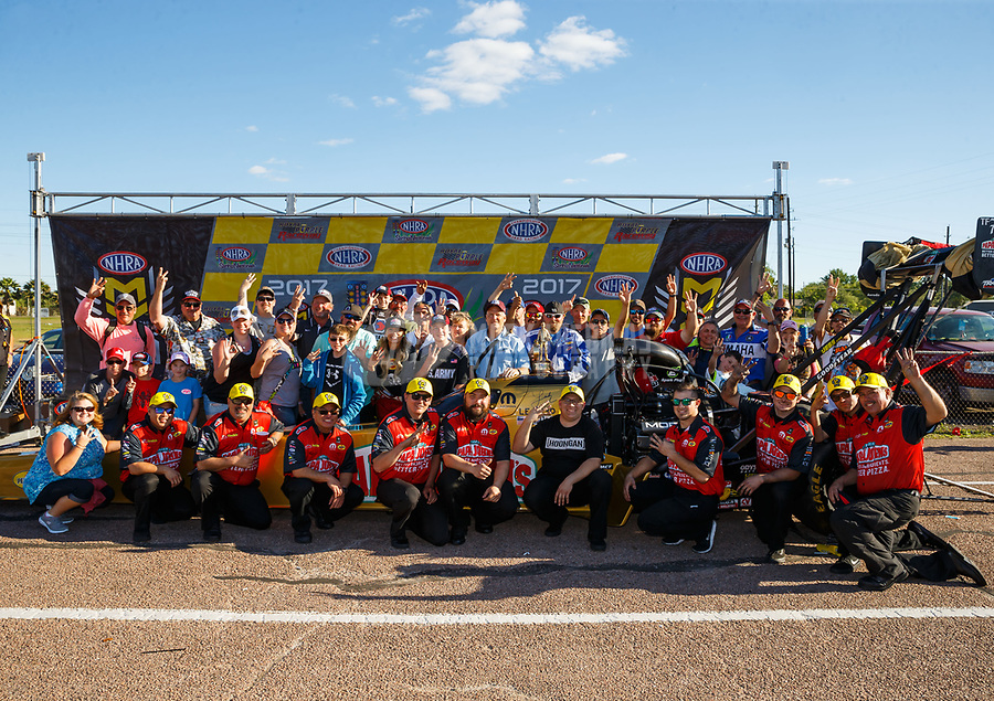 Apr 23, 2017; Baytown, TX, USA; NHRA top fuel driver Leah Pritchett poses for a photo with fans in the winners circle after winning the Springnationals at Royal Purple Raceway. Mandatory Credit: Mark J. Rebilas-USA TODAY Sports