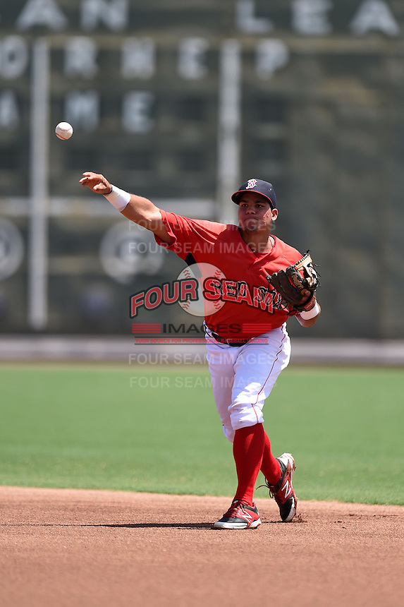 GCL Red Sox third baseman Rafael Oliveras (2) throws to first during a game against the GCL Rays on June 25, 2014 at JetBlue Park at Fenway South in Fort Myers, Florida.  GCL Red Sox defeated the GCL Rays 7-0.  (Mike Janes/Four Seam Images)