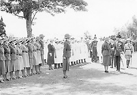 BNPS.co.uk (01202 558833)<br /> Pic: Pen&Sword/BNPS<br /> <br /> PICTURED:  Inspection in East Africa of the Kenya section of the W.T.S., the first of any recognized women's auxiliary unit to be authorized and trained outside Great Britain, 1938.<br /> <br /> These inspiring photos of nurses on the front line feature in a new book which charts a century's heroic wartime service.<br /> <br /> The First Aid Nursing Yeomanry (FANY) was founded in 1907 by Captain Edward Baker with the early recruits trained in cavalry, signalling and camping.<br /> <br /> They were despatched to France at the outset for World War One to tend to injured troops on the battlefield, setting up hospitals for the many casualties. Other heroines dragged wounded personnel from exploding ammunition dumps.<br /> <br /> The brave nurses were again in the centre of the action in World War Two, performing sterling work in the harshest of conditions.<br /> <br /> Their stories feature in The First Aid Nursing Yeomanry in War and Peace, by Hugh Popham.