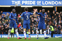 Chelsea's Marcos Alonso celebrates their victory at the final whistle with Antonio Rudiger and Kurt Zouma during Chelsea vs Everton, Premier League Football at Stamford Bridge on 8th March 2020