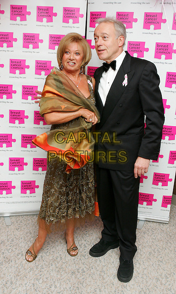 ELAINE PAIGE & NICHOLAS GRACE.Attends The Pink Ribbon Ball, The Dorchester Hotel,.London, England, October 6th 2007..full length black suit bow tie green khaki dress wrap.CAP/ROS.©Steve Ross/Capital Pictures