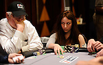 Melanie Weisner is near the chip lead going into level 6 on Day 1.  Here, she stares down an opponent.