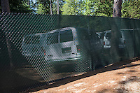 PINEHURST, NC - JUNE 15: Vans parked behind screens on the course. Scenes from the U.S. Open Championship at Pinehurst, North Carolina on Sunday, June 15, 2014. (Photo by Landon Nordeman)