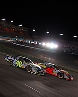 Apr 22, 2006; Phoenix, AZ, USA; Nascar Nextel Cup driver Jimmie Johnson of the (48) Lowes Chevrolet Monte Carlo passes Casey Mears during the Subway Fresh 500 at Phoenix International Raceway. Mandatory Credit: Mark J. Rebilas-US PRESSWIRE Copyright © 2006 Mark J. Rebilas..